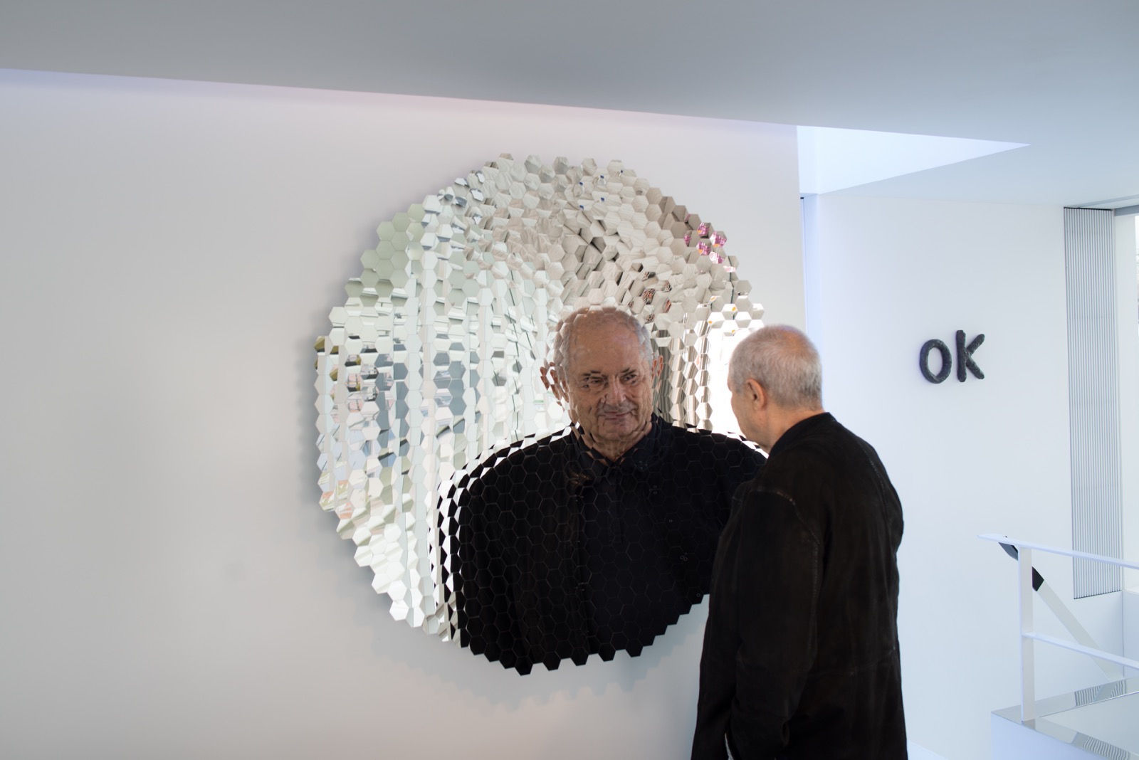 Self portrait Dakis Joannou's reflection in front of the Anish Kapoor mirror sculpture.